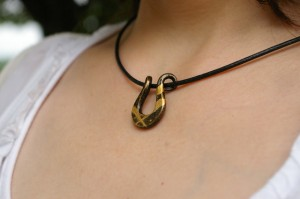 Japanese iron pendant with lacquer and gold