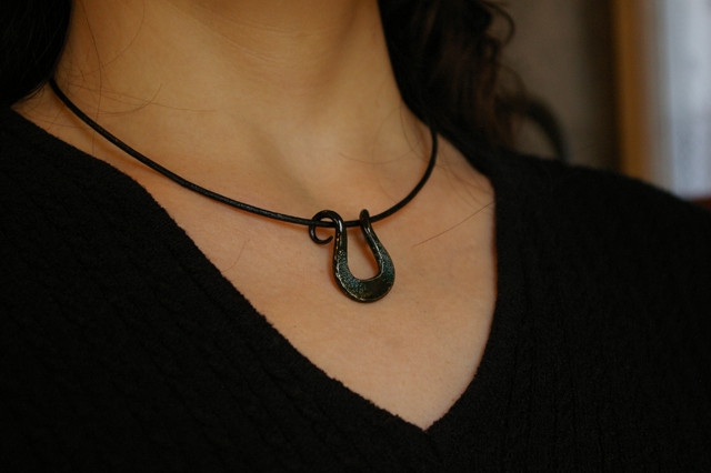 Japanese Horseshoe shaped blue necklace